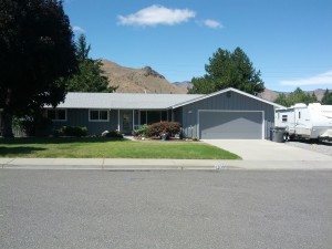 Wenatchee Residential Repaint Two Tone Description: Exterior: Remove all failing paint, apply Peel Bond primer on all exposed surfaces, paint body with soffit in second color.