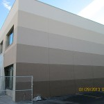 Exterior: Paint 5 colored stripes on exterior of commercial building. Interior: Paint interior in 5 colors.